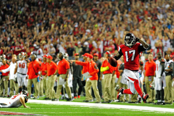 Devin Hester, shown returning a punt for a touchdown in 2014, has more combined return touchdowns (14 on punts, five on kickoffs) than anyone else in NFL history. Photo: Scott Cunningham/Getty Images