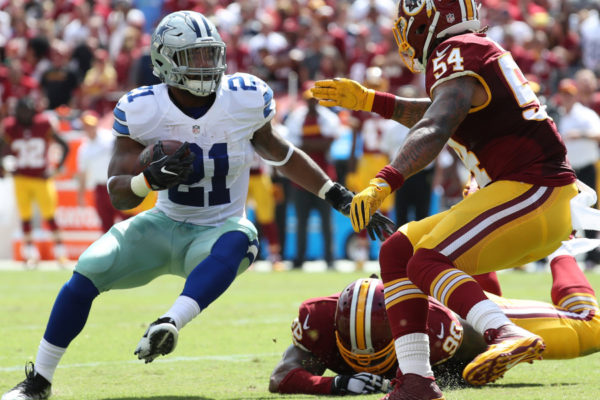 Sep 18, 2016; Landover, MD, USA; Dallas Cowboys running back Ezekiel Elliott (21) carries the ball as Washington Redskins linebacker Mason Foster (54) chases in the first quarter at FedEx Field. Mandatory Credit: Geoff Burke-USA TODAY Sports
