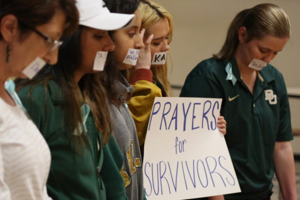 Current and former Baylor students hold a rally warning of sexually assaults on and off campus, Friday, June 3, 2016, in Waco, Texas. Calling the rally Un-silence the Survivors, they read an open letter to the administration about improvements on how the school should handle sexual assaults after observing a moment of silence. (Rod Aydelotte/Waco Tribune Herald, via AP)