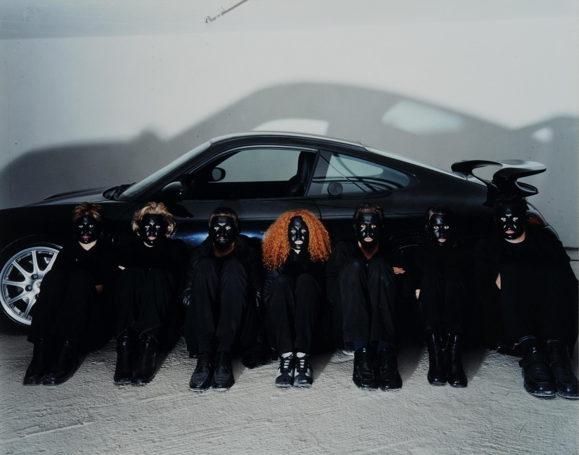 Breuning Olaf, 4 photographs: Apes, 2001; Primitives, 2001; Smiley, 2000; 911, 2000.