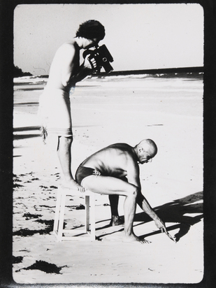 Wilp Charles Paul, 3 photographs: Beuys Drawing in the Sand, Filmed by C. Wilp, 1978; C. Wilp and his Team at the Opening of the Airport Jeddah in front of the King's Familiy; C. Wilp at the Airport