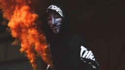 anonymous-mask-and-orange-smoke_600x338-mm-90