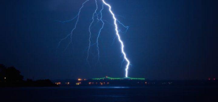 a giant lightning hitting a bridge