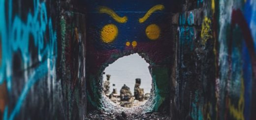 narrow passage that leads to the sea covered in graffiti