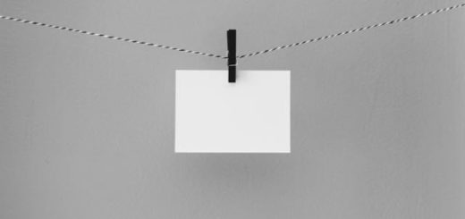 peace of white paper hanging on a string