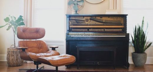 old piano with a reading chair with ottoman