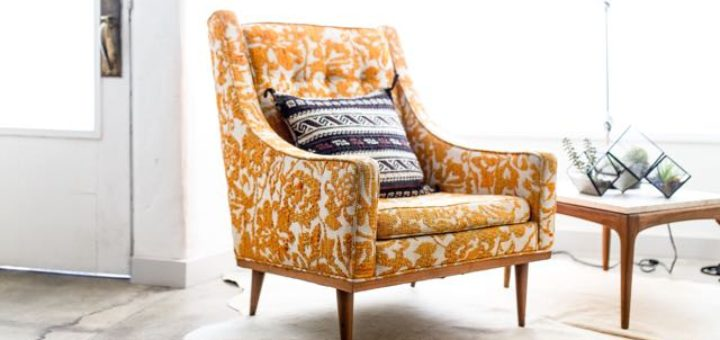 a yellow reading armchair in a brightly lit living room