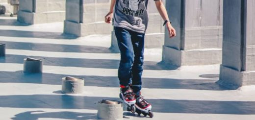 a boy roller blading between columns