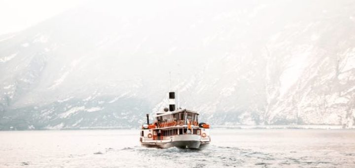 a ferry crossing a fjord