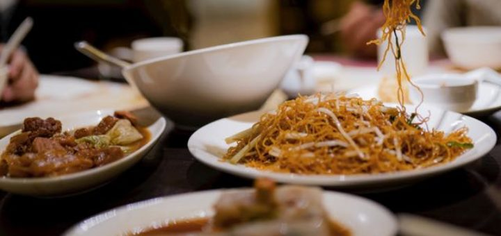 chinese food on table with chopsticks