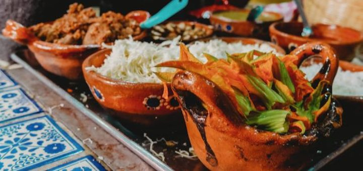 mexican food in clay pots on a counter