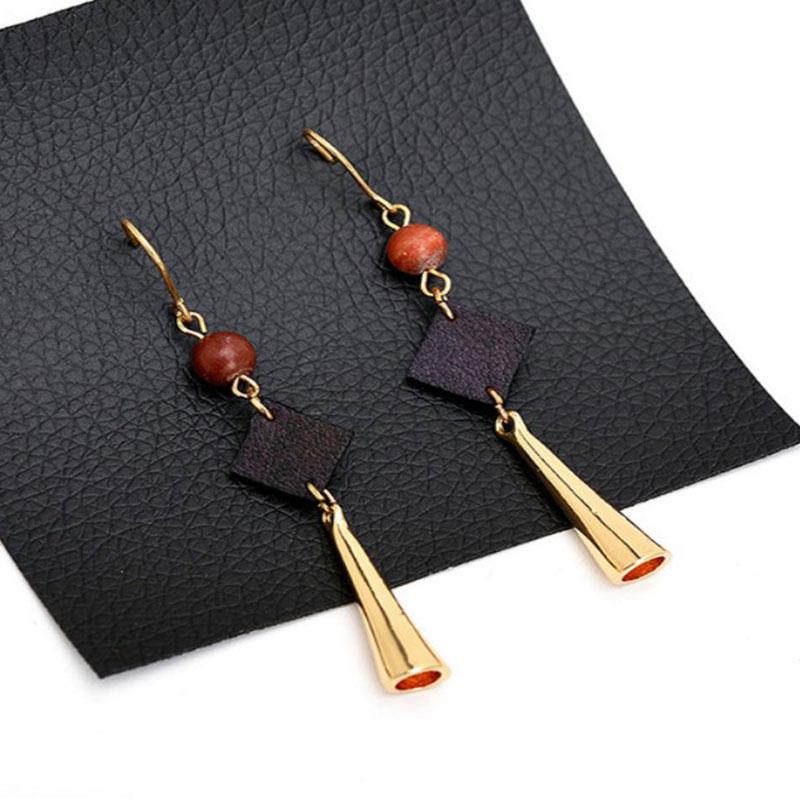 Κρεμαστά Σκουλαρίκια Drop Leather Bell Gold