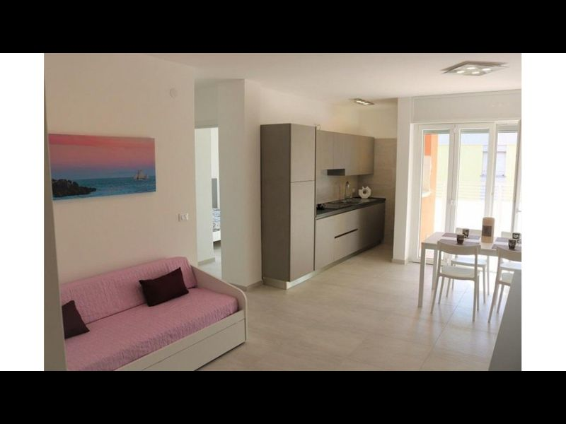 Modern two-room apartment with terrace 50m from the beach