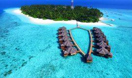 Strandbungalow på kristallklart vatten, en drömresa till Maldiverna
