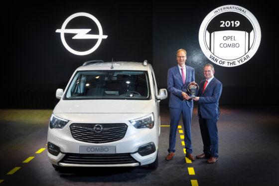 IVOTY 2019 - Opel/Vauxhall trophy handover photo with Jarlath Sweeney (right) and Michael Lohscheller