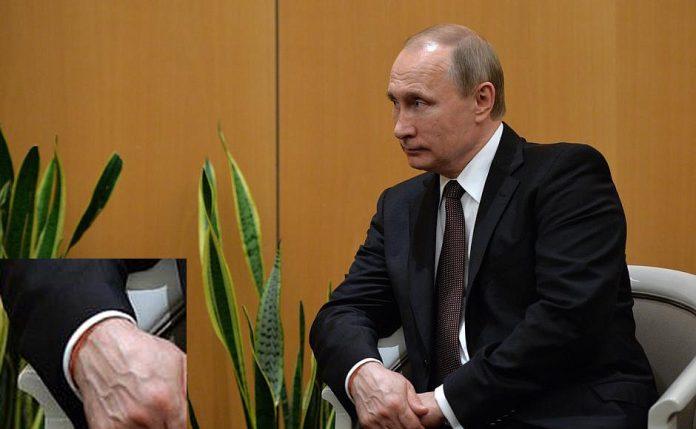 Красная нить на запястье Путина
