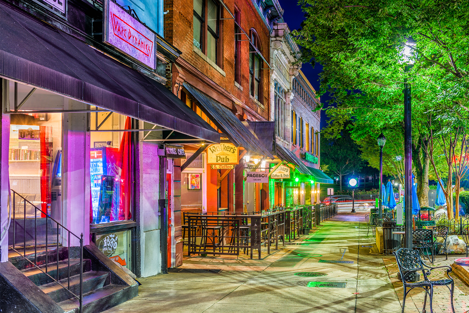 ATHENS, GEORGIA - AUGUST 13, 2017: Shops and bars along College Avenue in downtown Athens at night.
