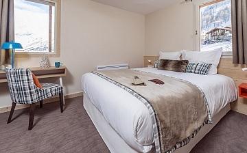 Ein Schlafzimmer in der Residenz Les Chalets du Jardin Alpin in Val d'Isere