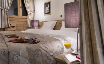 Montgenèvre · Ferienwohnungen · Le Chalet des Dolines - Schlafzimmer mit französischem Doppelbett.