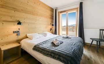 Unterkünfte · Ferienwohnungen & Chalets · Les Fermes du Mont Blanc · Combloux · Schlafzimmer