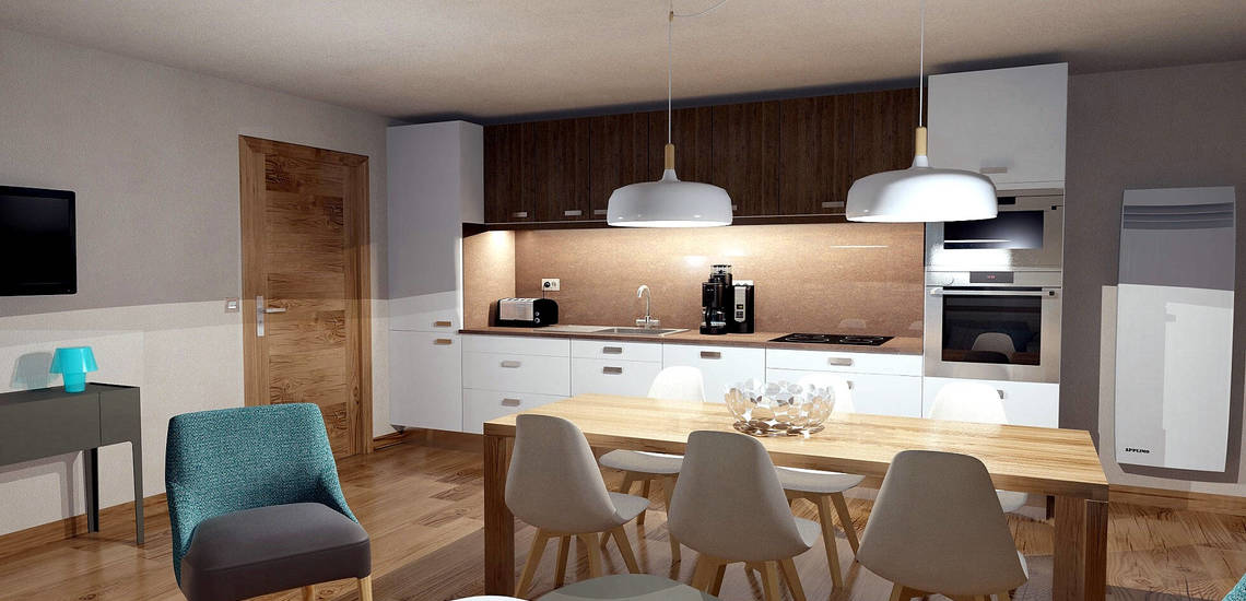 Essplatz und Küche in einer Ferienwohnung der Residenz Les Chalets du Jardin Alpin in Val d'Isere