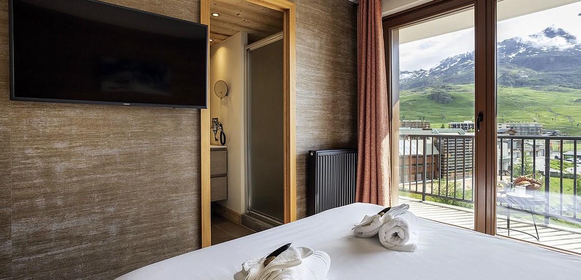 Ferienwohnungen Daria-I Nor in Alpe d'Huez - Schlafzimmer mit französischem Doppelbett