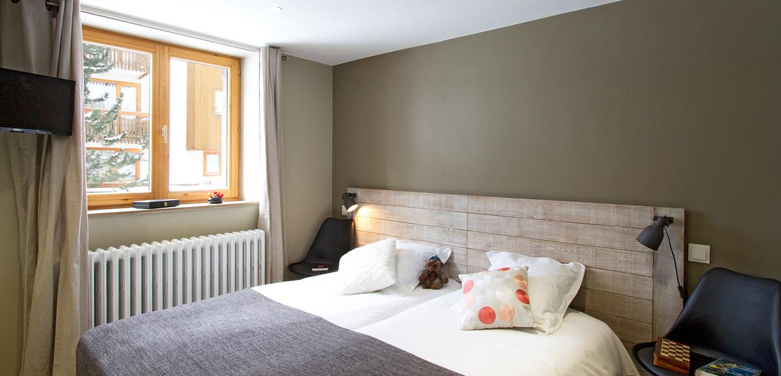 Val d'Isere · Chalet Le Cabri · Schlafzimmer mit Doppelbett