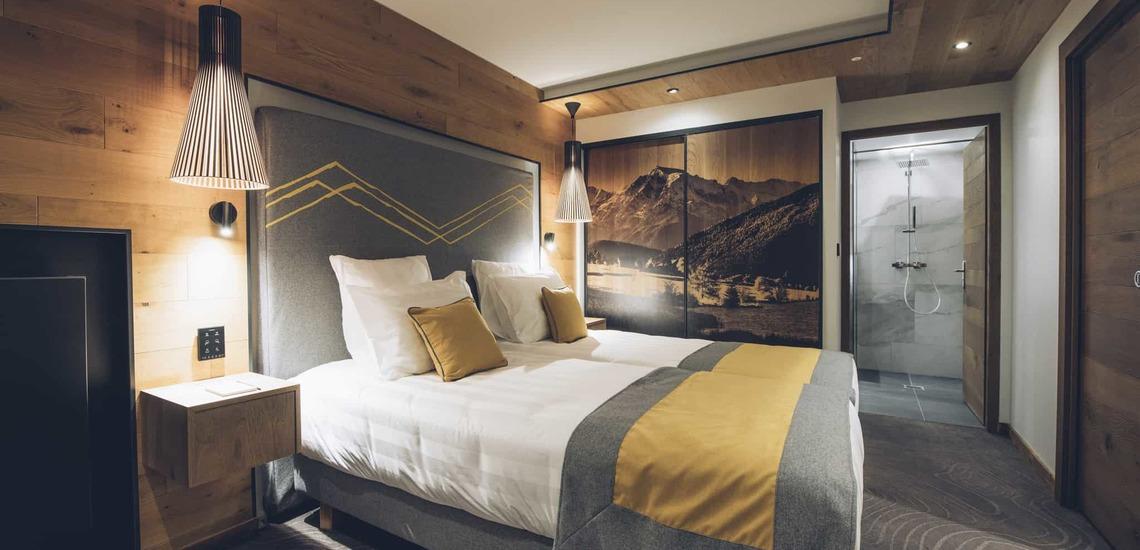 Ein Schlafzimmer im Alparena Hotel & Spa, Unterkünfte in La Rosiere, Skigebiet Espace San Bernardo, Skireisen/Skiurlaub in Frankreich, französische Alpen.