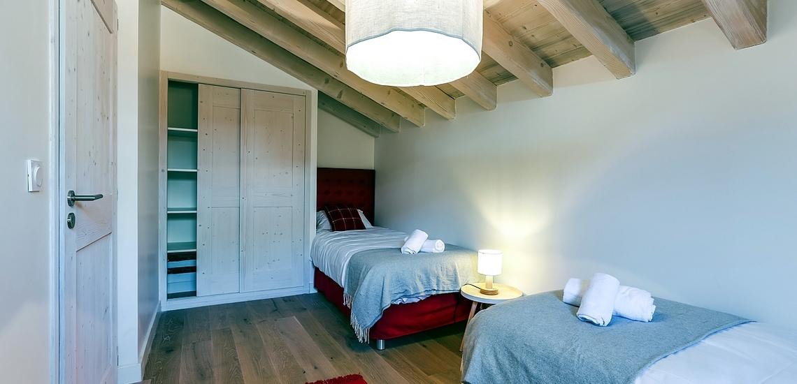 Unterkünfte · Ferienwohnung Le Hameau de Barthelemy · La Rosière · Schlafzimmer mit Einzelbetten