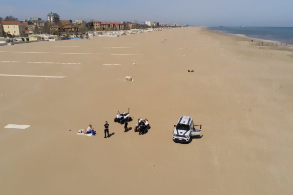 Drone footage of police forces stopping a sunbather in the town of Rimini, Italy, on April 16, 2020. © Comune di Rimini's Facebook account
