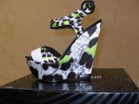 •N.11 paia di scarpe sandali a zeppe.