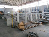 Impianto per l'assemblaggio termico di profili in alluminio