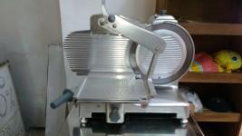 affettatrice elettrica in acciaio inox