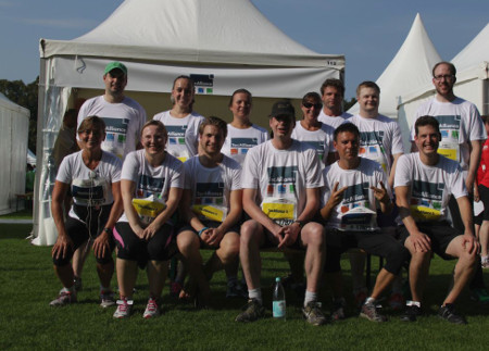 Some of TecAlliance's runners in front of the company tent.