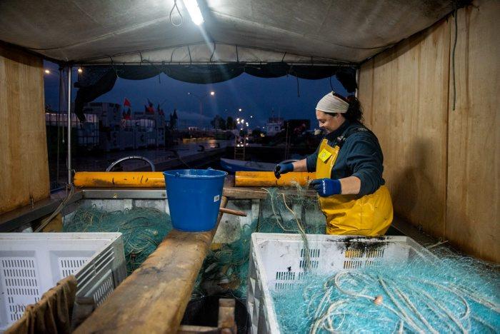 Una pescadora | Departament d'Agricultura