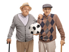 Disappointed seniors holding a deflated football Sky calcio