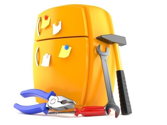frigorifero con attrezzi riparare gli elettrodomestici