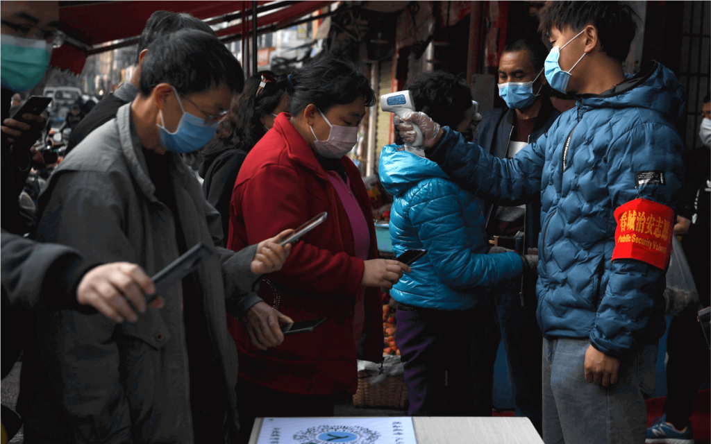 Chinese citizens use QR Codes to enter a market to go shopping during the coronavirus pandemic