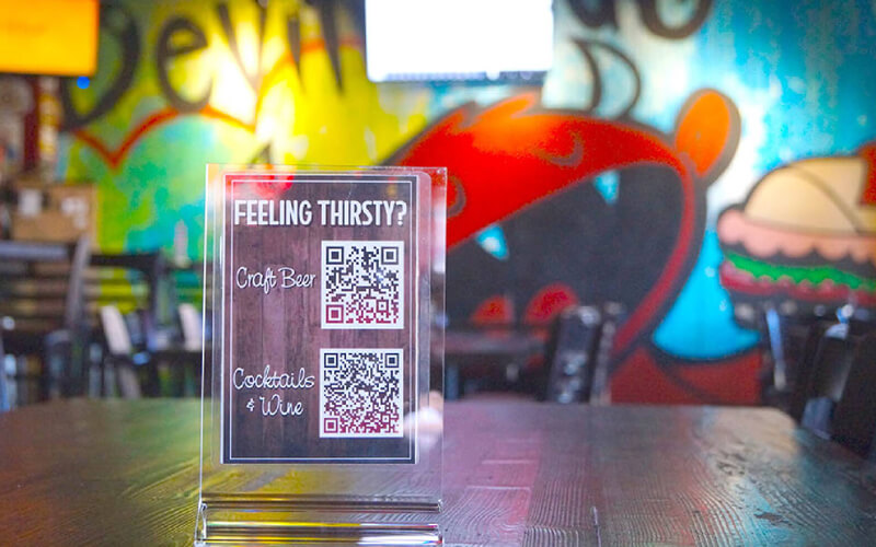 Devilicious Eatery's new QR Code menu displays create a social distancing safe environment for customers