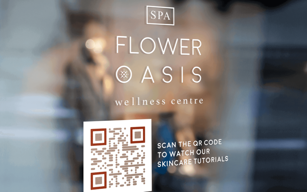 A door sign at a wellness studio uses a QR Code to connect passersby with digital content