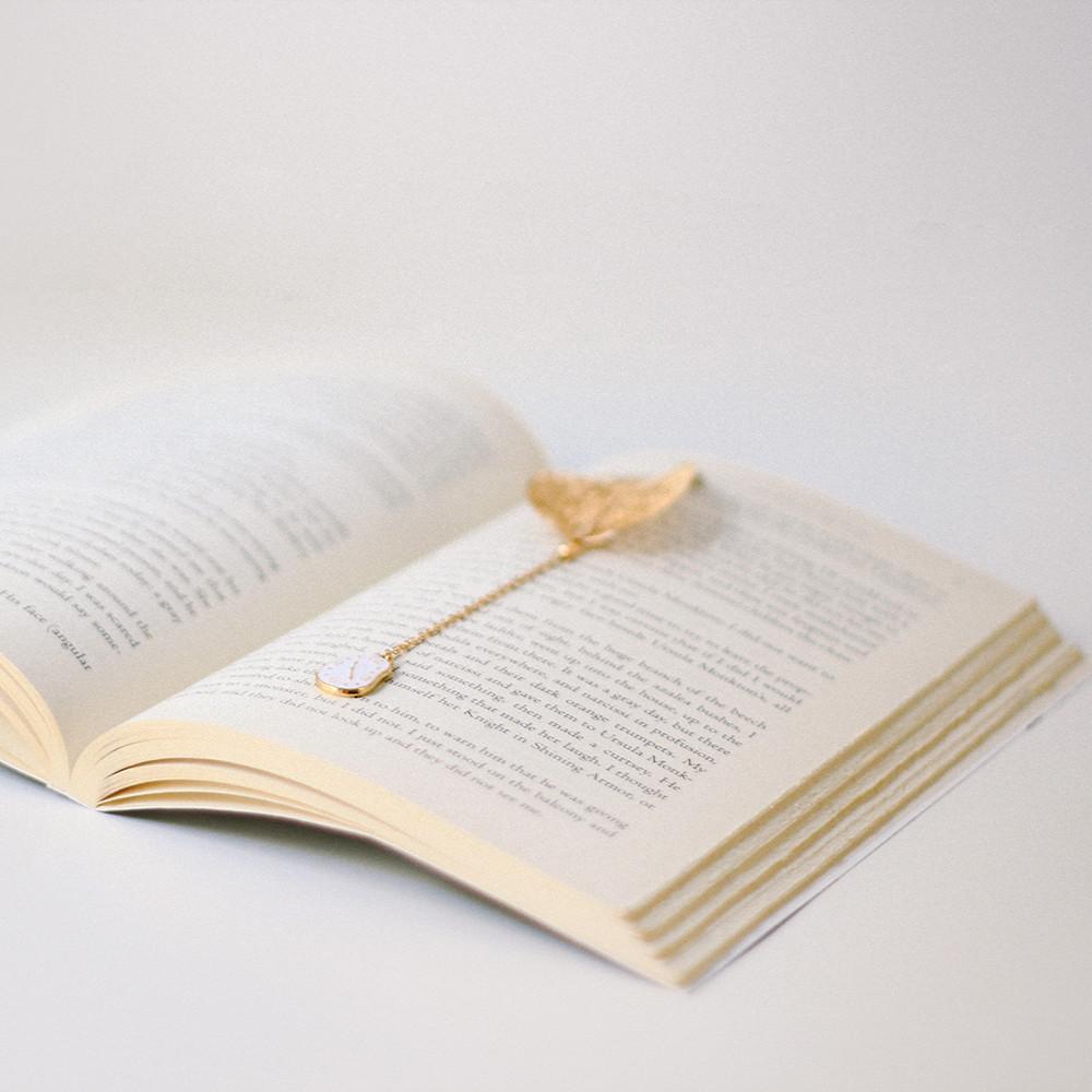فاصل كتاب فواصل كتب أليس في بلاد العجائب  ساعة عشاق الكتب لويس كارول