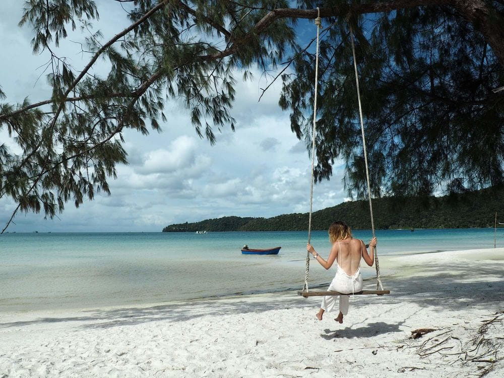 Me on the white sand beach swing