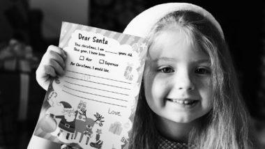 Mädchen hält eine Wunschzettel-Vorlage in der Hand.