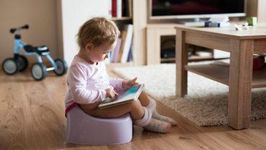 Bild: Kleinkind spielt mit Tablet