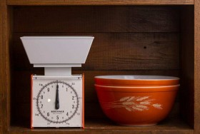a-pyrex-bowl-is-displayed-with-a-scale-at-updated-the-store