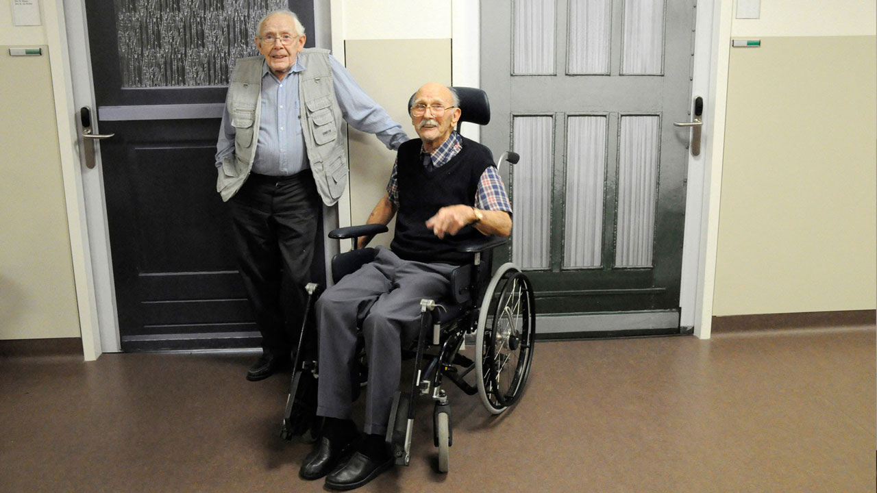 Two residents striking a conversation about their new True Door