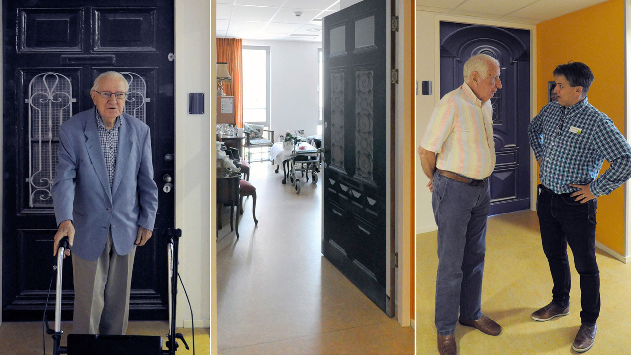 A resident in conversation with a staff member about his new True Door.