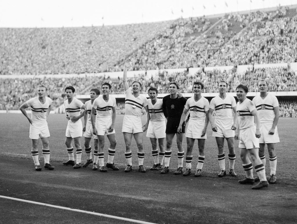 The Hungarian team celebrating victory in the Olympic football tournament