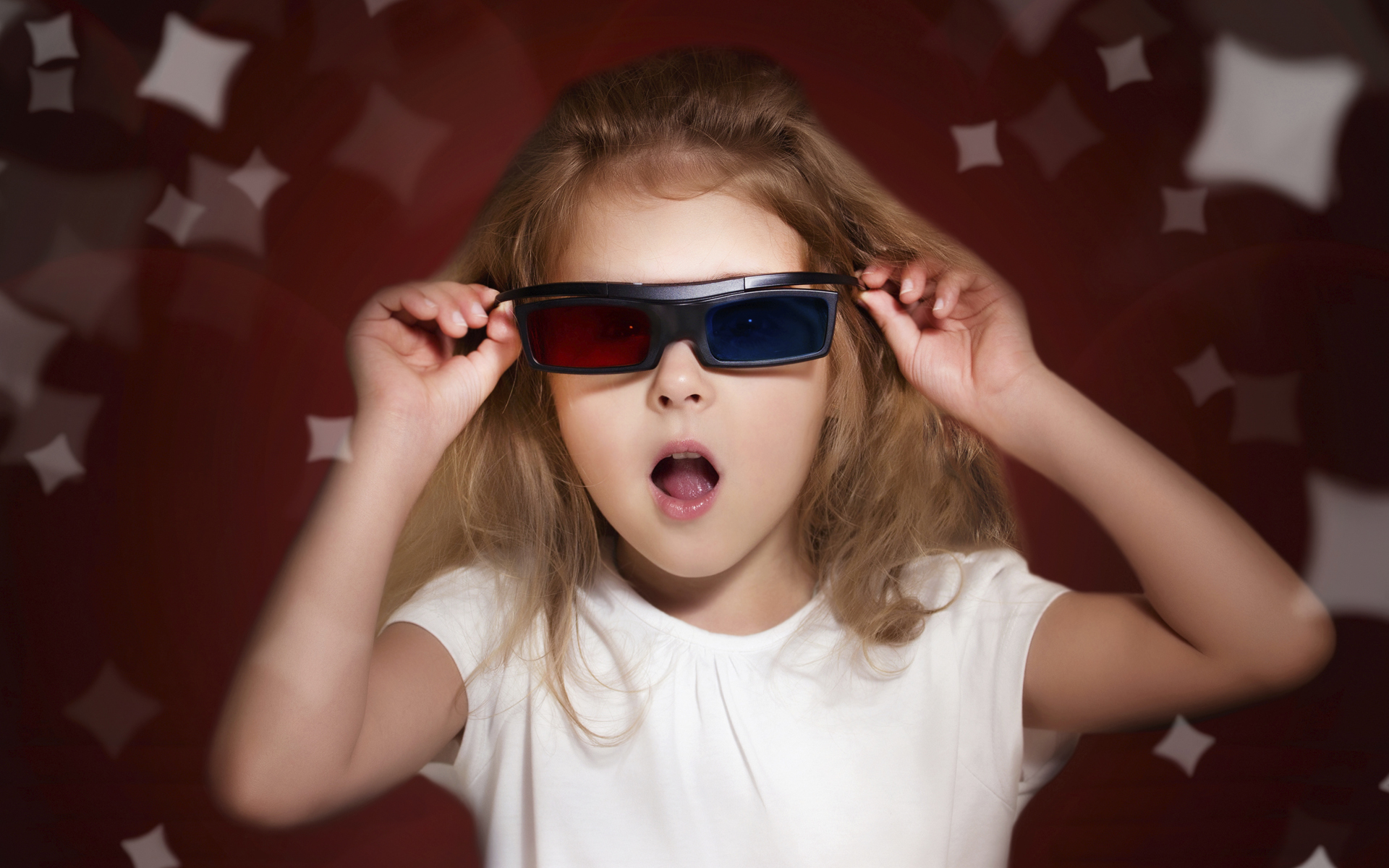 Child girl in 3d glasses watching movie.Kid in cinema.