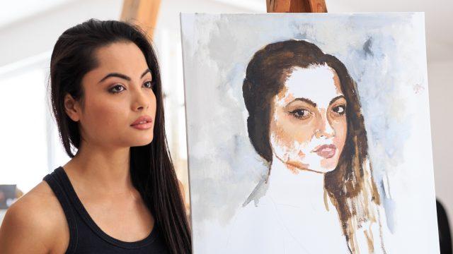 Künstlerin mit Selbstportrait